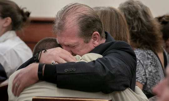 Tim Jones, Sr., embraces his son, Travis Jones during the sentencing phase of Tim Jones Jr.'s trial in Lexington, S.C., Wednesday, June 12, 2019. Timothy Jones, Jr. was found guilty of killing his 5 young children in 2014. (Tracy Glantz/The State via AP, Pool)