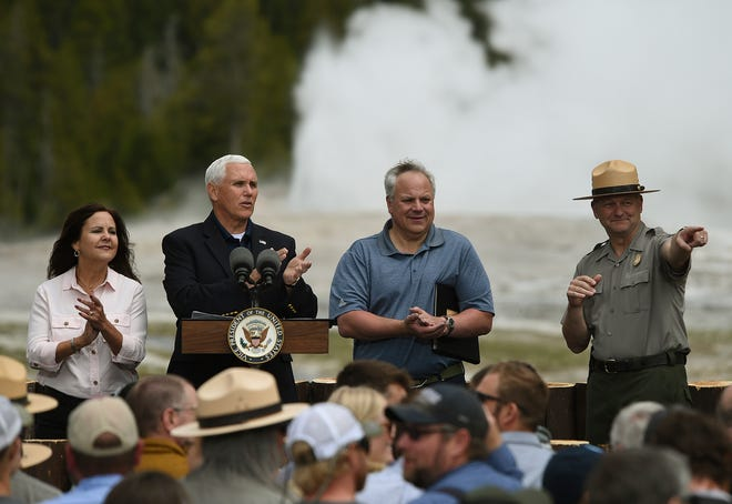 Vice President Mike Pence, his wife Karen, Interior Secretary David Bernhardt and Yellowstone Superintendent Cameron Sholly give a shout-out to a retiring employee, Thursday, June 13, 2019 in Yellowstone National Park in Wyoming. Vice President Mike Pence visited Yellowstone National Park Thursday to promote a plan to whittle away the more than $12 billion repair-and-maintenance backlog in parks across the U.S. (Larry Mayer/The Billings Gazette via AP)
