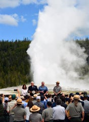 Vice President Mike Pence, his wife Karen, Interior Secretary David Bernhardt and Yellowstone Superintendent Cameron Sholly talk about infrastructure funding as Old Faithful Geyser goes off in the background in a June visit.