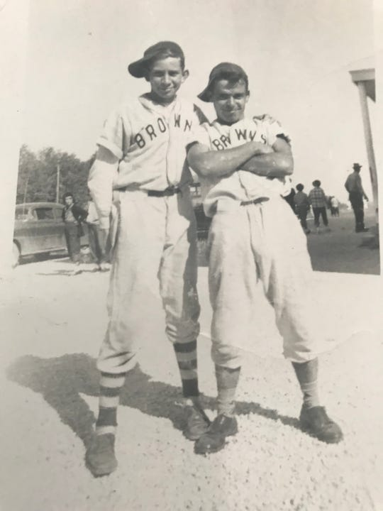 John A. Logan III (left) and teammate pose for an after-game picture in 1954.