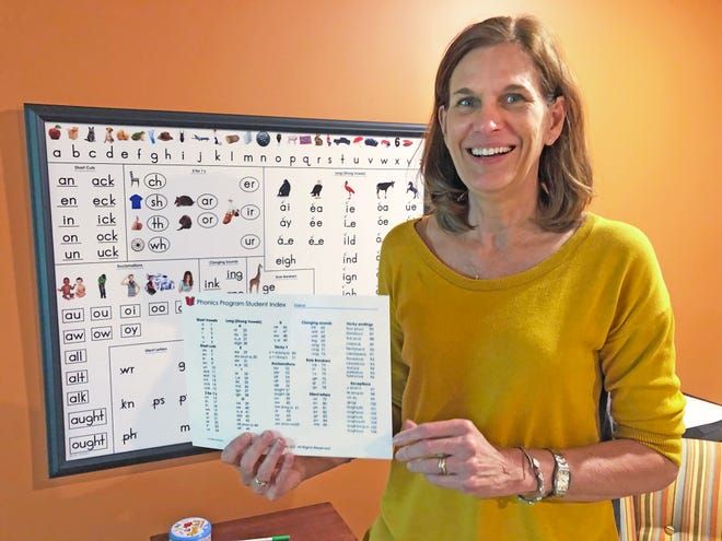 Longtime educator Jean Carver displays some of the classroom materials she developed for her Reaoniks phonics program to help teach reading. Phonics connects letters and letter combinations with how they are spoken aloud.