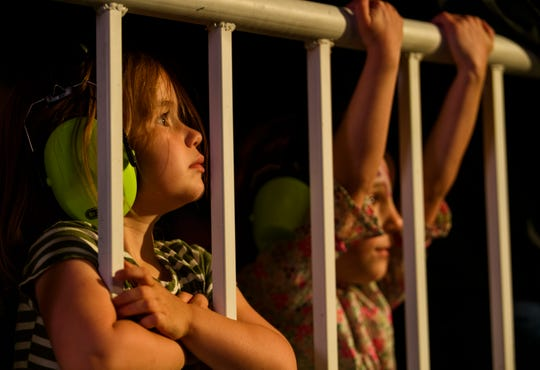Three-year-old Esme Mourer, left, and five-year-old Annabel Volz, right, watch Vanessa Collier perform during the first night of the W.C. Handy Blues & Barbecue Festival at Audubon Mill Park in Henderson, Ky., Wednesday, June 12, 2019.