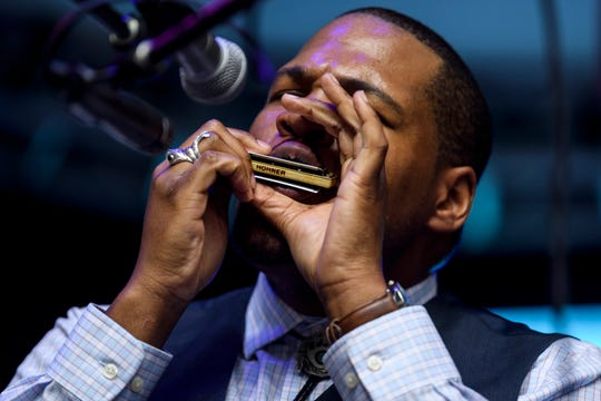 Jerron 'Blind Boy' Paxton plays harmonica for the crowd during his set on the first night of the W.C. Handy Blues & Barbecue Festival at Audubon Mill Park in Henderson, Ky., Wednesday, June 12, 2019.