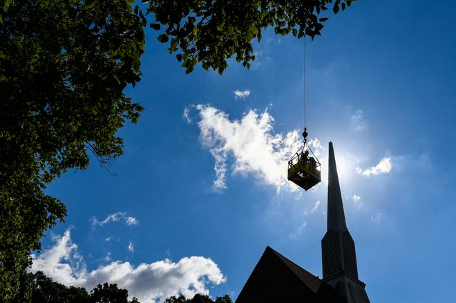 Crews from General Steel and Campbellsville Industries remove a 39-foot-tall steeple from the Presbyterian Church of Henderson Thursday. The 1,500-pound structure will be refurbished and returned in 10 to 12 weeks, June 13, 2019.