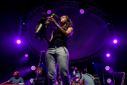 Vanessa Collier plays saxophone during the first night of the W.C. Handy Blues & Barbecue Festival at Audubon Mill Park in Henderson, Ky., Wednesday, June 12, 2019. She was named the Blues Foundation's 2019 Horn Player of the Year.