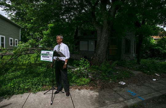 Indiana Senator Jim Merritt stands outside of a vacate property listed to be renovated, Thursday, June 13, 2019, in Indianapolis, IN.