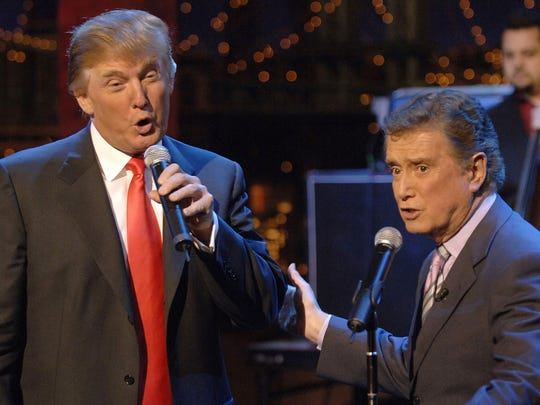 "Donald Trump, left, and Regis Philbin sing a duet of ""Rudolph the Red-Nosed Reindeer"" during a 2005 episode of ""Late Show with David Letterman."""
