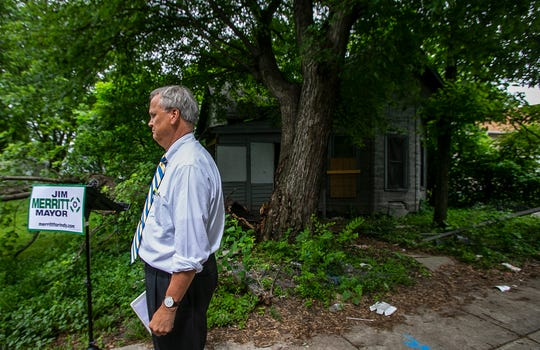 "Indiana Sen. Jim Merritt stands outside of a vacant property in the 1200 block of Talbott Street on Thursday, June 13, 2019, in Indianapolis. Merritt called Mayor Joe Hogsett's plan to rehabilitate 2,000 homes in two years ""fraud"" and outlined his own plans to tackle the city's housing blight."