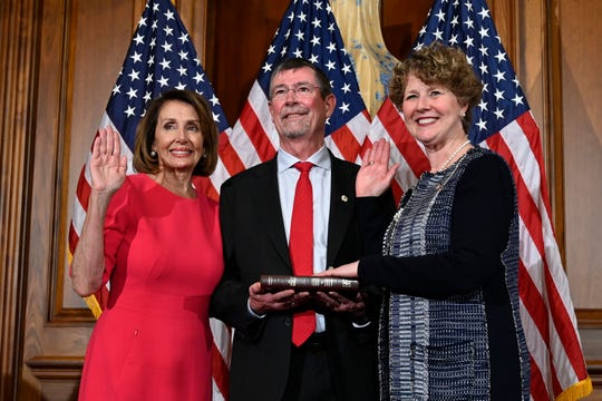 House Speaker Nancy Pelosi of Calif., left, poses during a ceremonial swearing-in with Rep. Susan Brooks, R-Ind., right, on Capitol Hill in Washington, Thursday, Jan. 3, 2019, during the opening session of the 116th Congress.