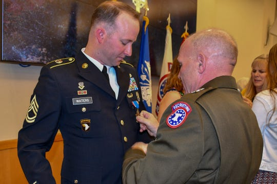 Gregory Waters receives the Distinguished Service Cross in a ceremony June 5. The award is is the second highest military medal a soldier can receive, just below the Medal of Honor.