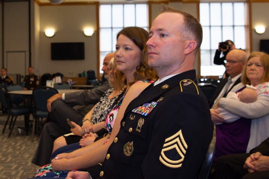 Waters, his wife and family listen as Maj. Gen. Frank Muth delivers the opening remarks for the Distinguished Service Cross ceremony. The award is is the second highest military medal a soldier can receive, just below the Medal of Honor.