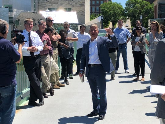 Jeff Harney, assistant director for UI Facility Management, led a walking tour around the University of Iowa campus for the Iowa Flood Center's 10th anniversary.