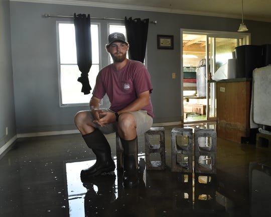 "Parker Adcock, 25, sits in the dining room of his flooded Holly Bluff home.  ""It was kind of my stepping stone coming out of school. I put what I did have, what I made during school into it… now it's a total loss,"" Adcock said. Adcock expects that the worst is yet to come. His wife is having a baby boy in December and he's doubtful he'll have a permanent place to stay by then. In addition to losing his home, the young farmer won't have a crop this year. Tuesday, June 11, 2019."