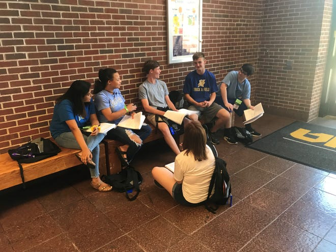 Tennessee Teen Institute campers discuss strategy for tackling an issue during the opening day of camp on Monday at UT Martin.