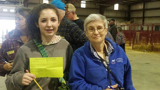 LeeAnn Martin with Becky Peterson, Shropshire Association secretary, at the National Shropshire Sale in Eaton, Ohio. May 11, 2019.