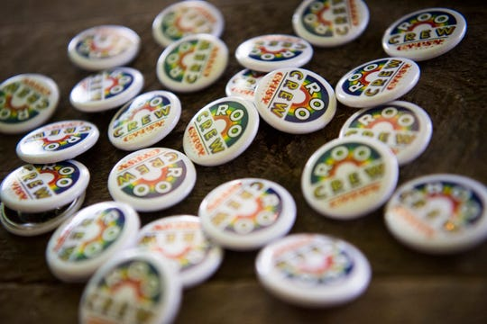 Gypsy Circus Cider Co. pins are seen at Bonnaroo Music and Arts Festival in Manchester, Tenn., Thursday, June 13, 2019. Gypsy Circus is the only craft cider company at Bonnaroo this year.