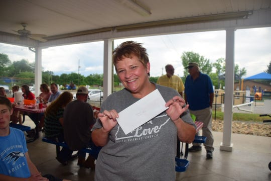 Melissa Gingrinch won a $50 dollar gift certificate to Target on Clinton Hwy. at the second annual Lions Club Shrimp Boil held at the Lions Club pavilion Saturday, June 8.