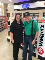 Store manager Connie Johnson welcomes her first customer, Donnie, on June 13, 2019.