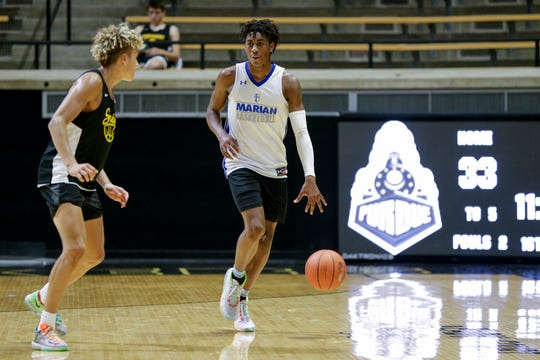Mishawaka Marian's Jaden Ivey (13) dribbles down the court during a high school basketball camp, Thursday, June 13, 2019 at Purdue University in West Lafayette.