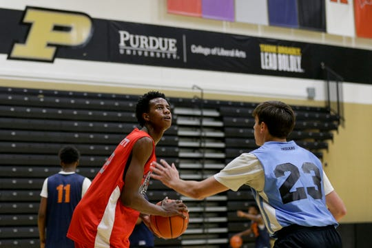 Evansville Bosse's Kiyron Powell (52) pauses before going up for three during a high school basketball camp, Thursday, June 13, 2019 at Purdue University in West Lafayette.