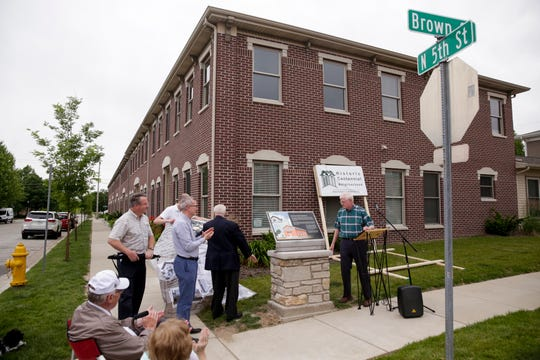 The Historic Centennial Neighborhood Association unveils a historic marker at the former site of Saints Mary and Martha Catholic Church, Wednesday, June 12, 2019 in the Centennial Neighborhood of Lafayette. Saints Mary and Martha was the first Catholic Church in Lafayette.