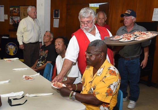 Keith Bourque, Opelousas Elks Lodge #1048 member, serves the first course of the meal to St. Joseph and St. Michael Center for Veteran Men residents.