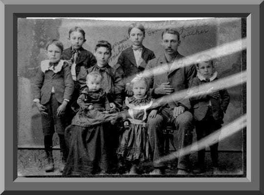 """Lester """"Lastie"""" Simon and wife Euphemie Abshire are pictured with all but their youngest, who was born in 1903. This likely was taken circa 1902."""