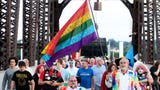 Members of the Louisville community held a memorial for the Pulse shooting tragedy in Orlando on the Big Four Bridge.