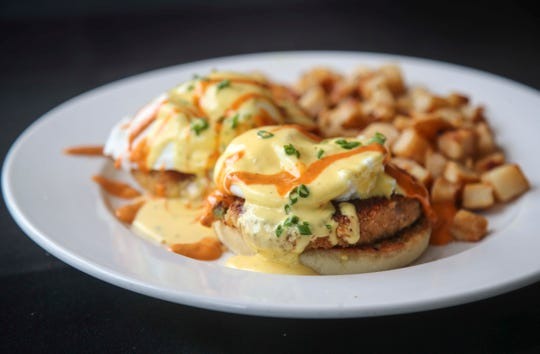 The crab cake Benedict features housemate jumbo crab cakes with skillet potatoes at Highland Morning. June 13, 2019.