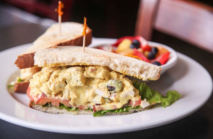 The St James' curry chicken salad sandwich features chunks of roasted chicken breast, almonds, diced celery, chopped red onions, golden raisins in a housemaid dressing at Highland Morning. June 13, 2019.