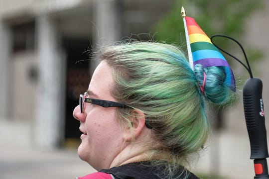 Dyed hair and rainbow flags are prevalent each year at Michigan Pride Parade in downtown Lansing and festival held each year in Old Town.