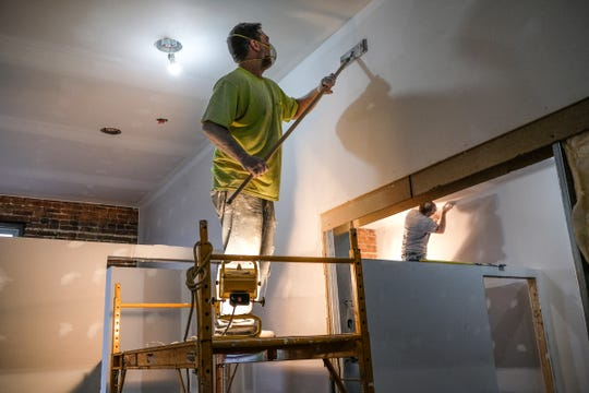 Mickey McKay sands drywall in the apartments in the F.C. Mason building in St. Johns Thursday, June 13, 2019.