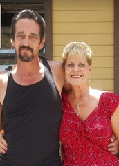 Antonio M. Lujan - Tony - stands with his mother, Doris Yell.