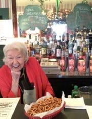 Kathie Bundy behind the bar at Kathie's Stage Door Pub in downtown Manitowoc.