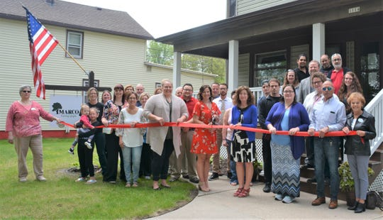 A ribbon-cutting ceremony was held recently at MARCO Services, Inc., 1114 S. 11th St., Manitowoc, to celebrate the 40th anniversary at its current location. Assisting Gina Wotruba, executive director, with the ribbon-cutting are her staff; residents; Chamber Executive Director Karen Nichols; members of The Chamber's Board of Directors; and Chamber Ambassadors.