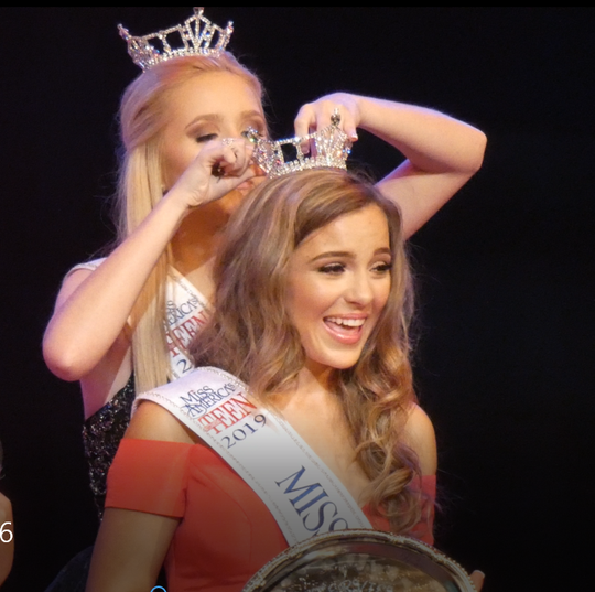 Juliana Heichel pins the crown on her successor, the new Miss Ohio's Outstanding Teen Madison DeFrank, 18, of New Albany, Wednesday night at the Renaissance Theatre in Mansfield.