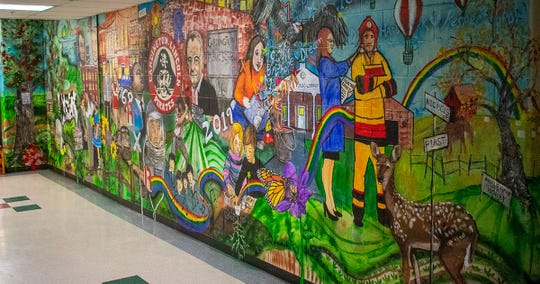 "Thanks to a donation from Cardington Class of 1969, this mural is on display at the elementary school. The mural is titled ""The Past, Present and Future of Cardington."""