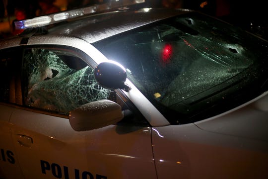 A Memphis Police Department car with its windows smashed at the scene of a police shooting in Frayser on June 12, 2019.