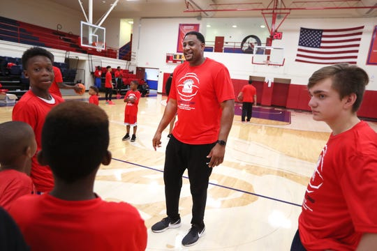 Southwest Tennessee Community College basketball Coach Cedric Henderson, former Memphis State basketball great and NBA player, leads a youth recreational basketball camp on Thursday, June 13, 2019.