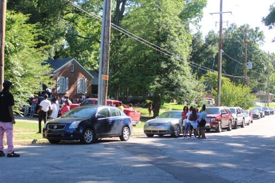 Close to 100 people gathered outside of a home on Thursday near where 20-year-old Brandon Webber was shot and killed at by a US Marshal Wednesday night.