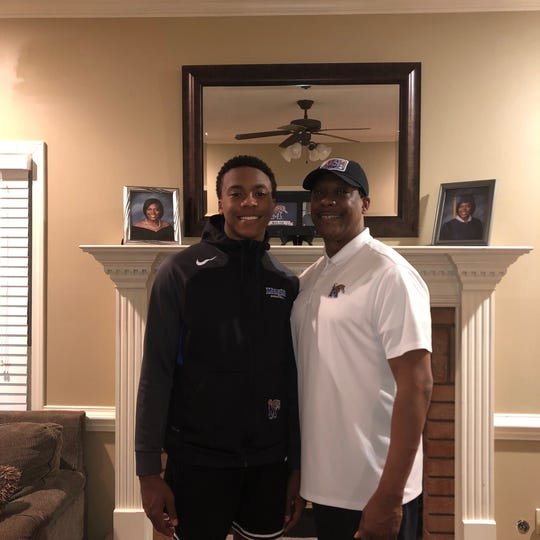 Memphis assistant coach Tony Madlock and his son T.J. Madlock inside their home.