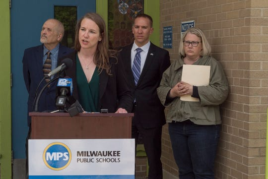 Milwaukee Public Schools board member Megan O'Halloran criticizes Republican lawmakers' proposed education budget at a news conference Thursday.  Also taking part were, from left, MPS Board President Larry Miller, Sen. Chris Larson, D-Milwaukee, and Milwaukee Teachers Education Association President Amy Mizialko.