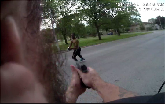 A still from a Milwaukee police officer's body camera, released in a criminal complaint, appears to show Javon Lewis, 34, and the officer aiming their guns at each other. Prosecutors say Lewis fired four shots at officers, one hitting an officer's holster at his waist.