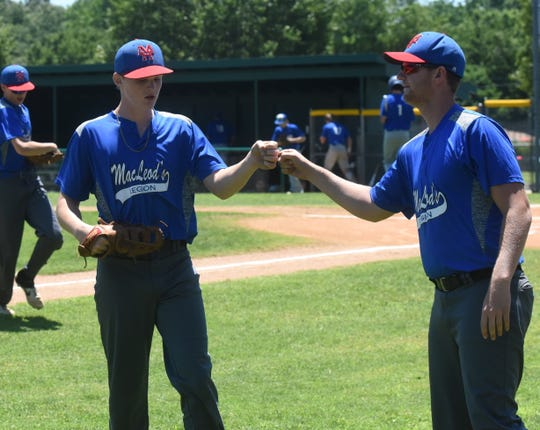 MacLeod pitcher Andrew Cantway is congratulated by assistant coach Jon Martin after a strikeout against Harrison on Thursday.
