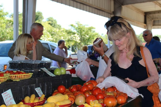 Betty Tomboli shops for fresh produce at the Monroe Farmer's Market on  Thursday. The Monroe Farmer's Market celebrated its grand opening for the 2019 season with an assortment of fruits, vegetables and other products ready for purchase.