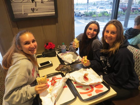 Nearly 500 people lined up before 5 a.m. for the 7 a.m. grand opening of Morris County's first Chick-fil-A restaurant, in Morris Plains. First on line were, from left, Rachel Tomiano of Randolph Lexie Glinbizzi of Randolph and Kim Sisto of East Hanover, shown here enjoying their first meal.