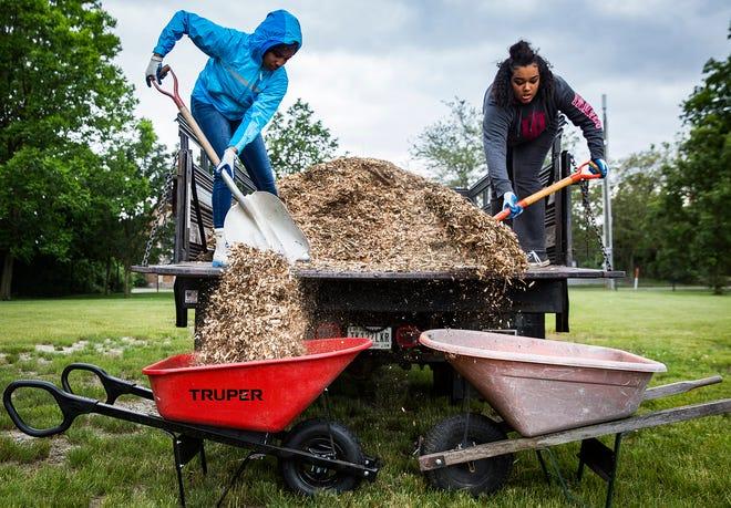 TeenWorks participants spread mulch at Minnetrista during a past summer job program.