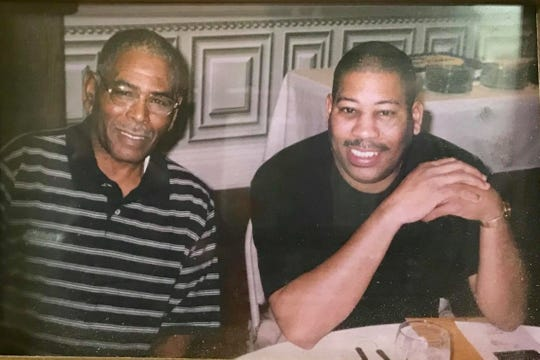 Ron Washington, right, and his father, John Washington Jr.