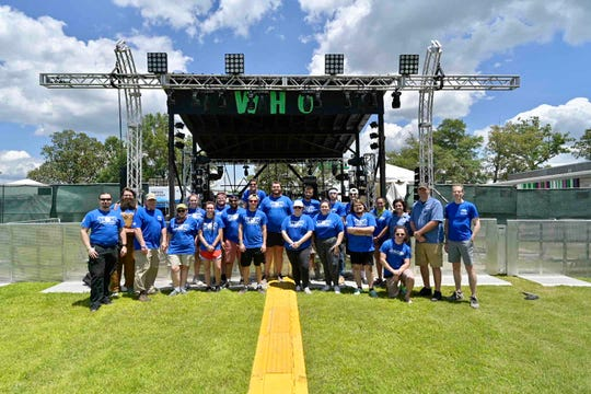 Audio and video production students from MTSU's College of Media and Entertainment assemble in front of the Who stage at the 2019 Bonnaroo Music and Arts Festival in Manchester, before beginning work Thursday to record performances at the venue.