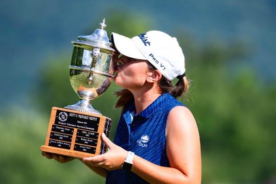 Former MTSU golfer Hanley Long kisses the Scott S. Probasco Trophy after winning the 2019 Women's Amateur Championship.